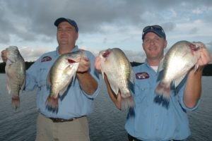 Kent Watson and Matt Morgan show off some crappie they caught at Grenada Lake in Mississippi. (Photos by John N. Felsher)