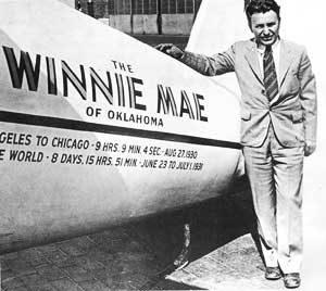 Wiley Post and his plane, the Winnie Mae