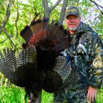 Under some very difficult conditions this huge NE Missouri gobbler ended-up in the fryer instead of on a limb. (Photo by Bob Cowman)